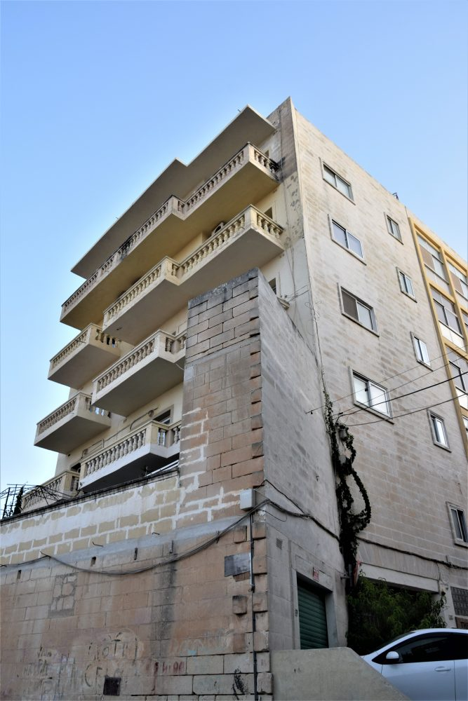 Balconied apartment building in which Giljana is located