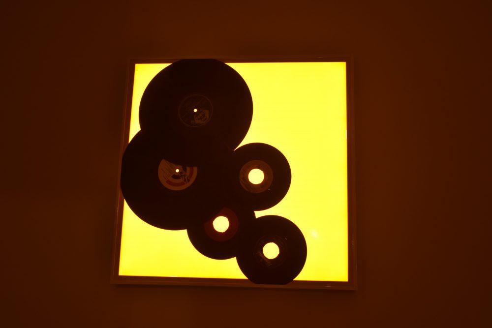 Illuminated music disc art work on the wall in 'The Music Room', Giljana