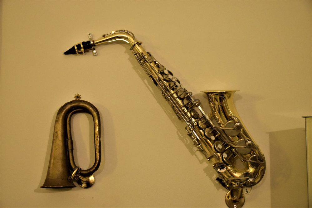 Saxophone and bugle on the wall in 'The Music Room', Giljana