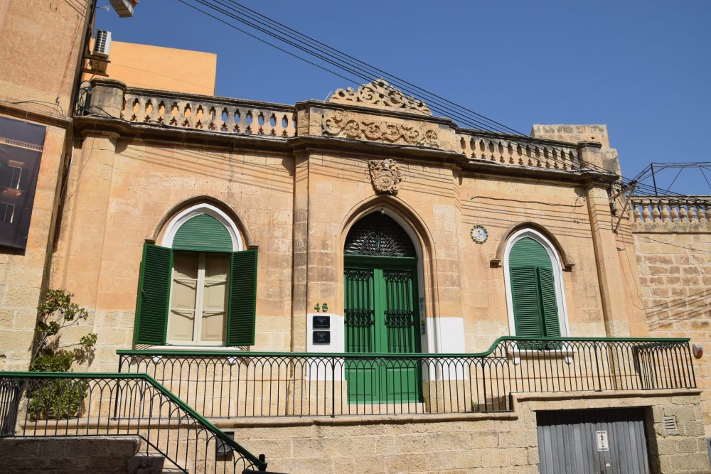 Green shutters and balcony at St Julian's Malta