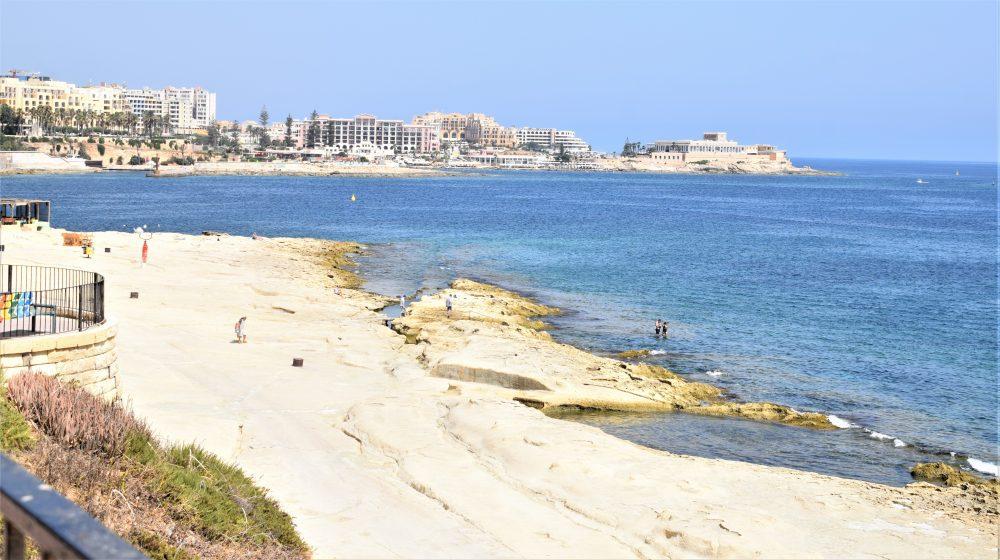The rocky beach at Sliema