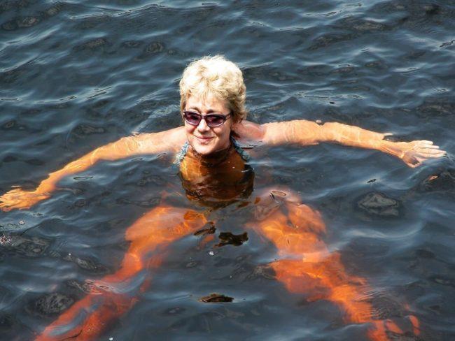 Sue swimming in the Amazon, Brazil