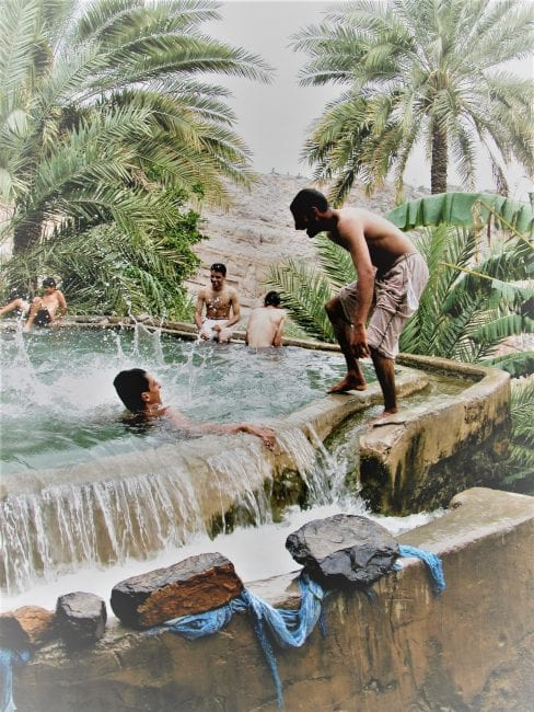 Boys frolicking in the water channels, Bahla, Oman