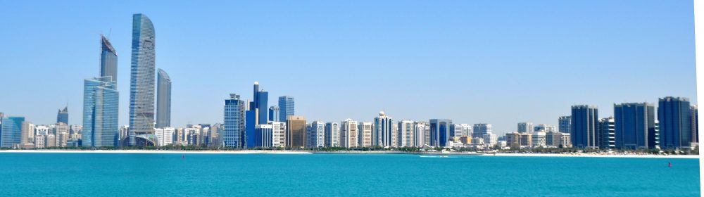 A panoramic view of skyscrapers lining the bay at Abu Dhabi
