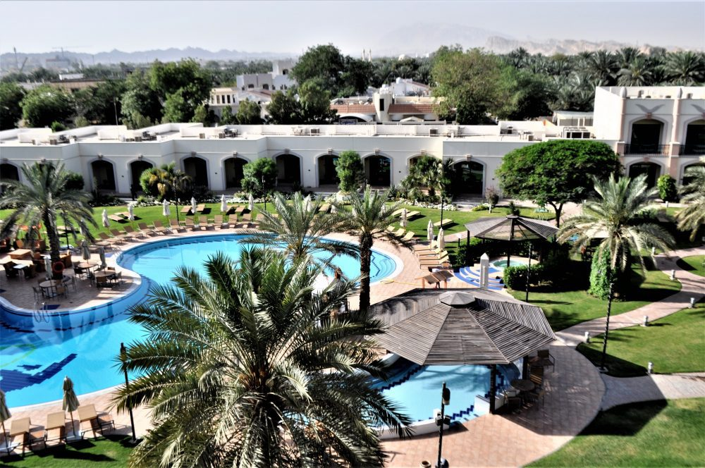 The view from my room at the Rotana Hotel, Al Ain, across the swimming pool to the city and oasis