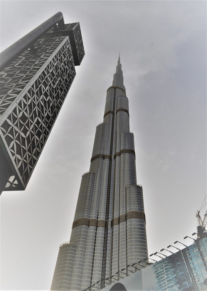 Shot of the Burj Khalifa and another tower block from below, Dubai