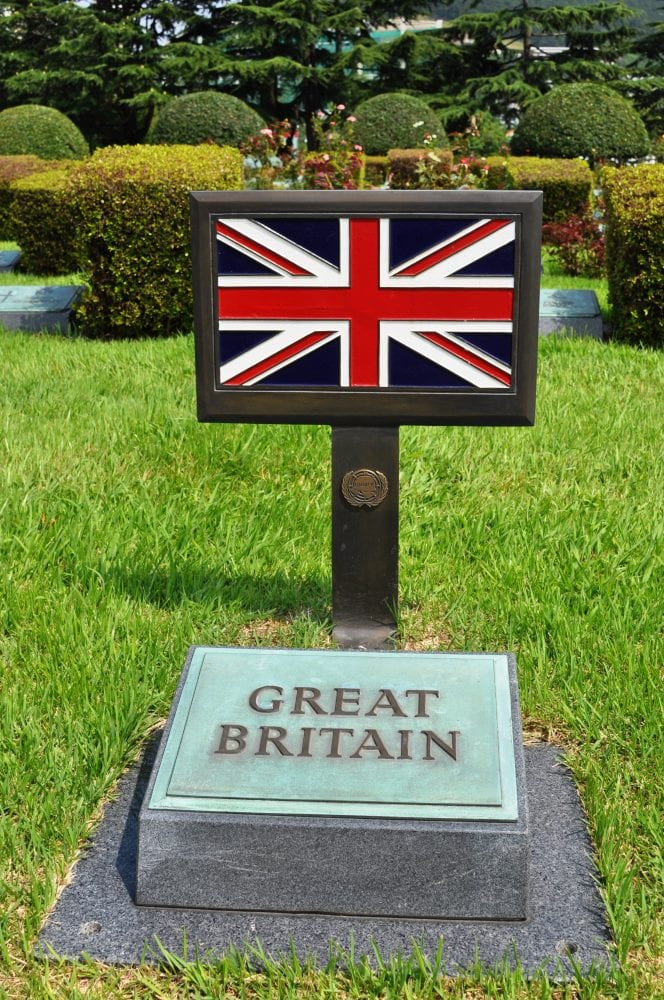 A Union flag plaque marks the British section in the cemetery at Busan