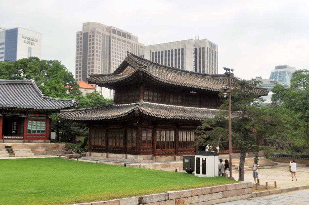 A two tiered wooden building in the Deoksugung Palace complex Seoul