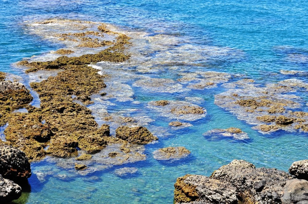 Rock pools against a brilliant turquoise sea, Taiwan