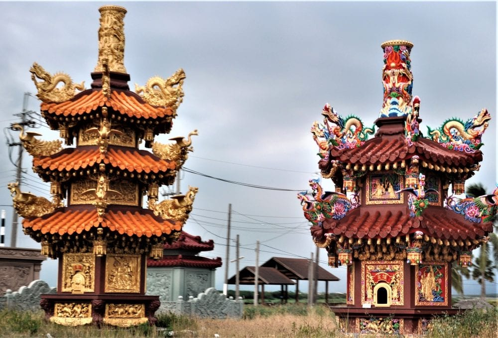 Two highly decorated Tao roadside shrines