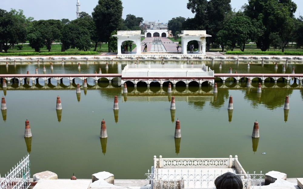 Walkways and arches in the centre of the lake at the gardens near Lahore, Pakistan
