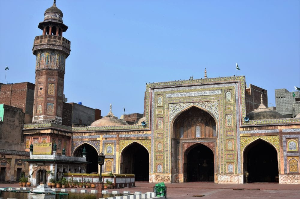 The minaret and entrance facade of an old mosque in Lahore, Pakistan