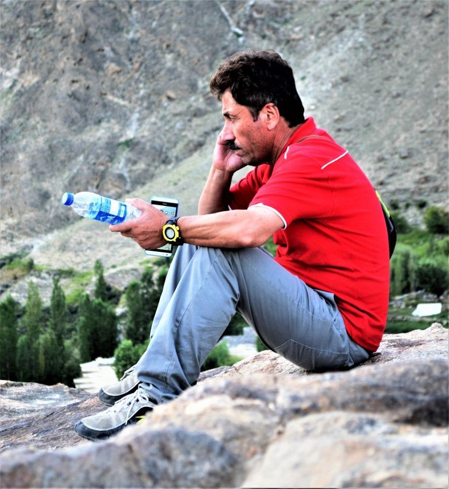 Attar on the phone at the Rakaposhi viewpoint Pakistan