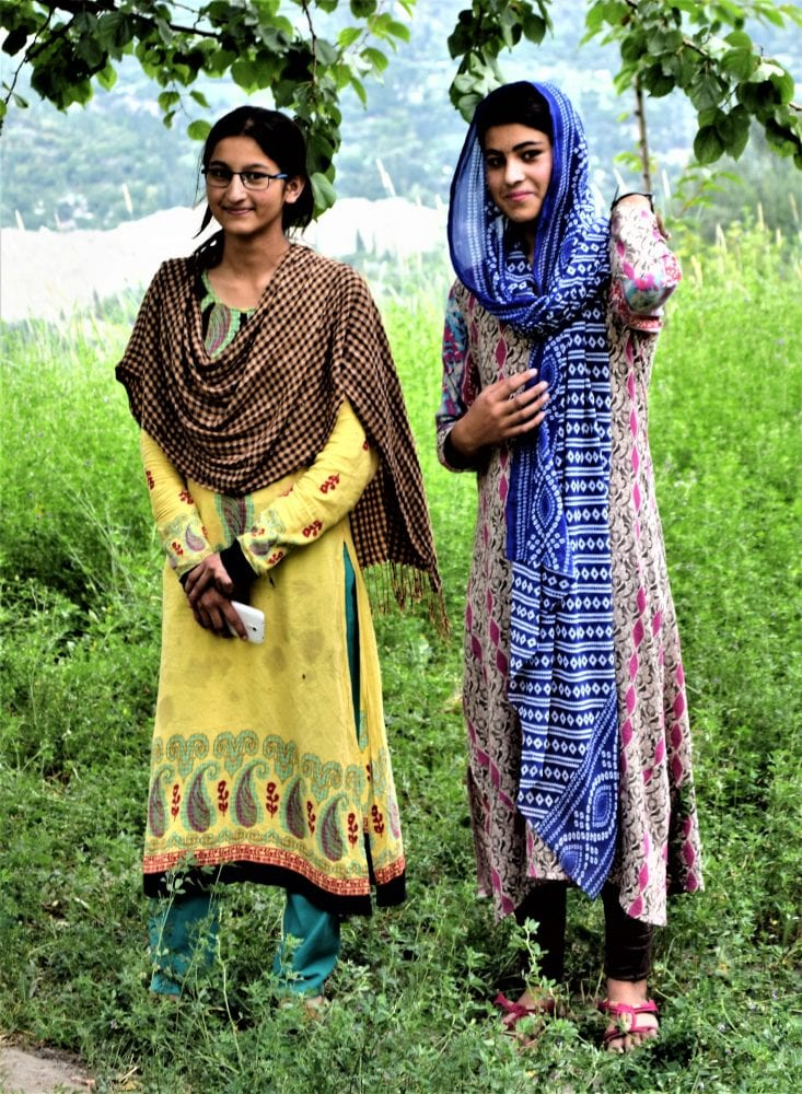 Two female Pakistani students in the gardens at Karimabad
