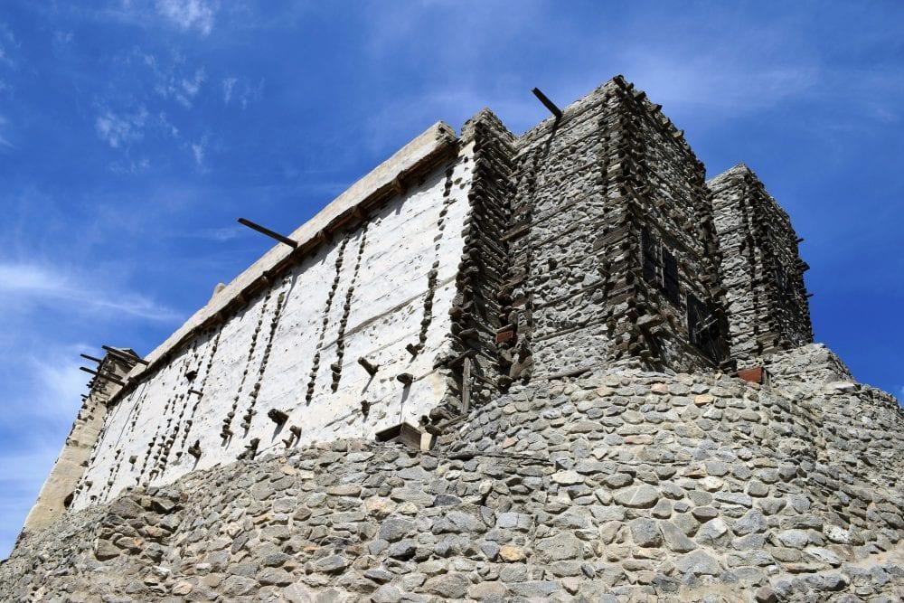 The large fort at Altit taken from below framed against a blue sky
