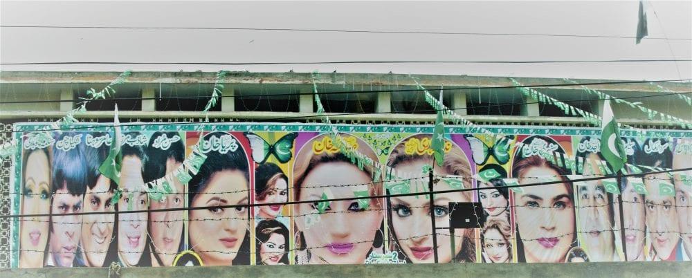 Pakistani film stars on a Lollywood banner,
