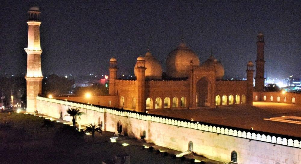 The illuminated Badshahi Mosque and the Lahore Fort at night, Pakistan