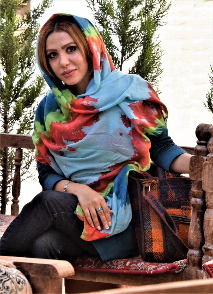 An elegant Iranian lady in a brightly coloured headscarf