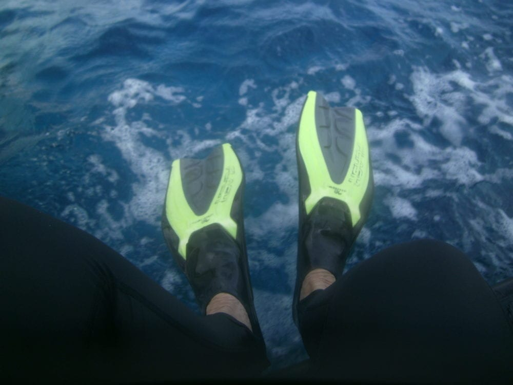 My feet as i jump into the sea from the whale boat