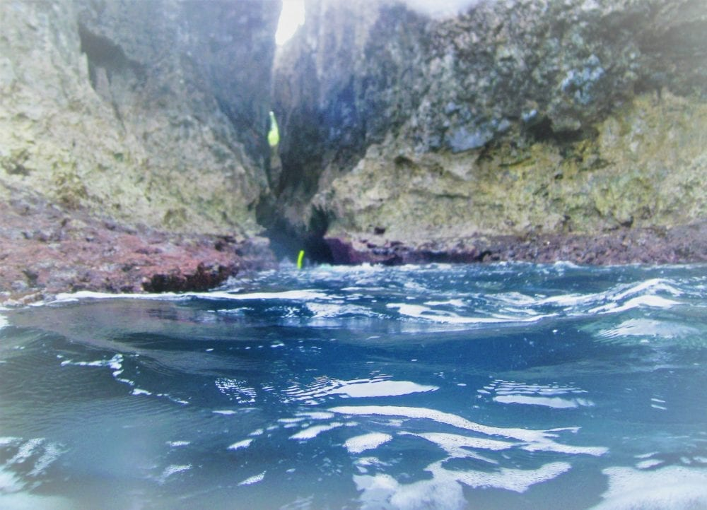 Snorkelling through a chasm on Niue