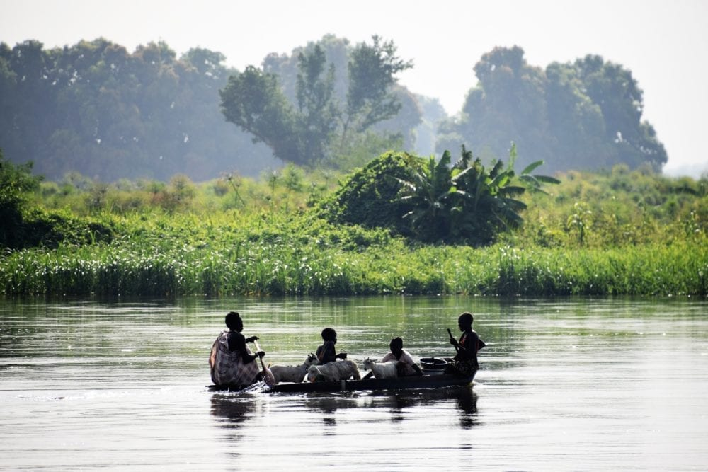 Four men in a boat on the Nile