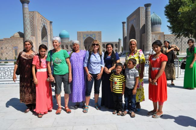 Sue in front of the Registan with tourist group Sue and visiting local families