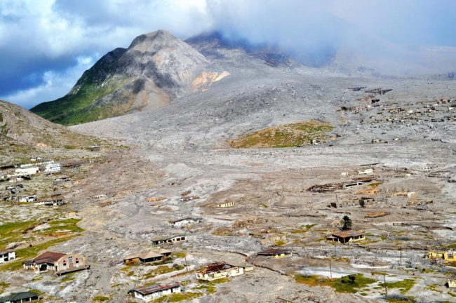 Buildings in different stages of despair in the path of the lava flow, Soufriere Volcano