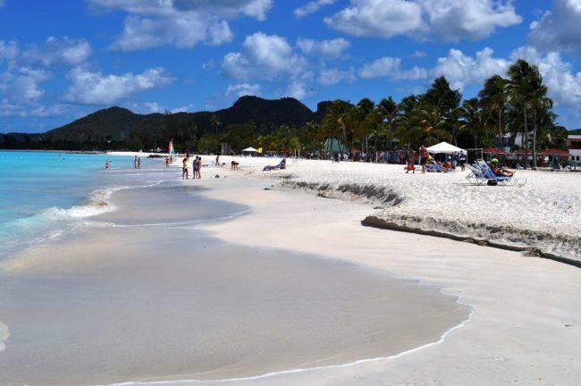 he white beach at Jolly Harbour Antigua, beach bars behind