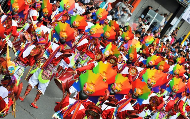 A view form above of a traditional costumed group at Pasto Carnival