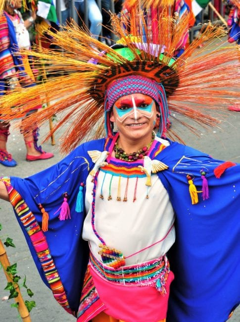 Costumed lady in the procession at Pasto Carnival, Colombia