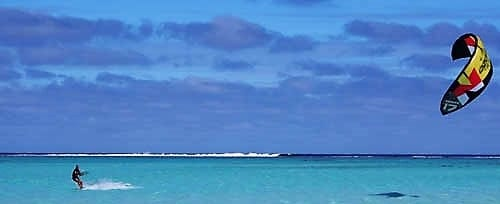 A solitary kite surfer on the lagoon Cook Islands