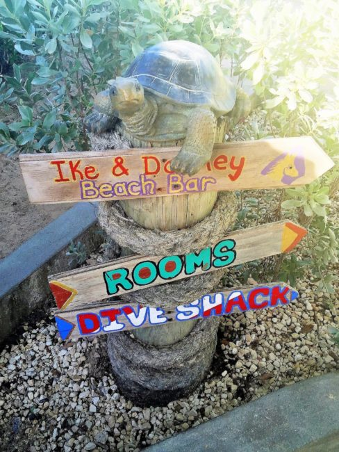 Painted wooden signs to parts of my hotel on Grand Turk