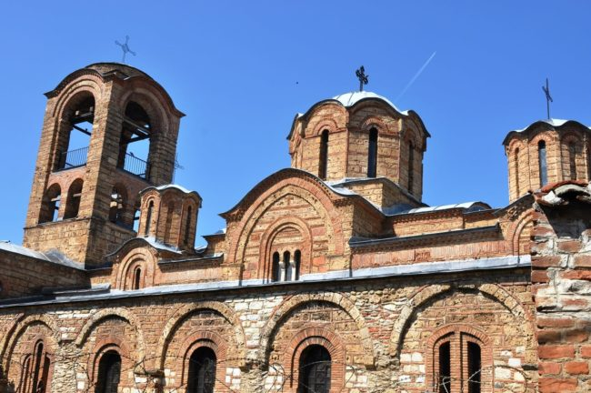Front view of a red brick monastery in Prizren