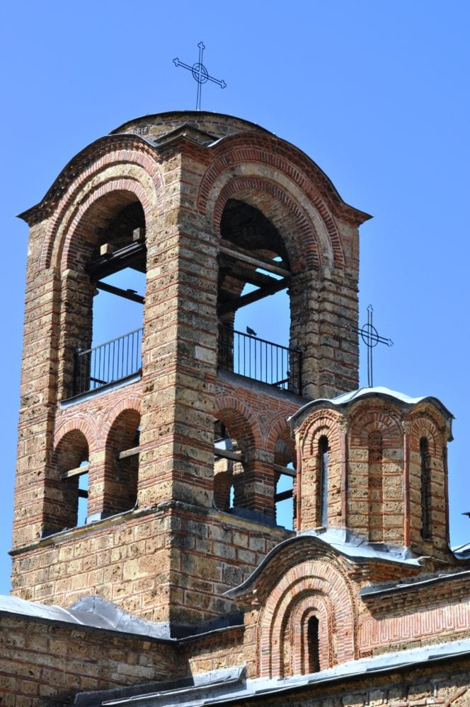 A close up of a monastery tower in Prizren