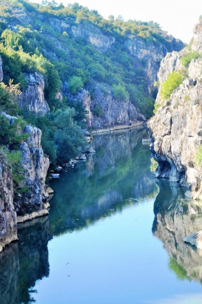 A gorge reflected in blue water, Kosovo