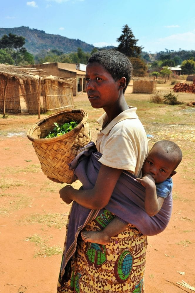 A young mother carrying a baby on her back in Malawi