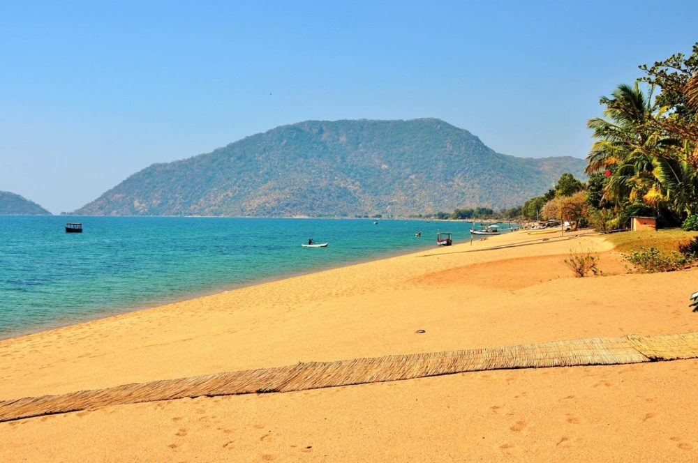 Golden sand and turquoise water at Lake Malawi