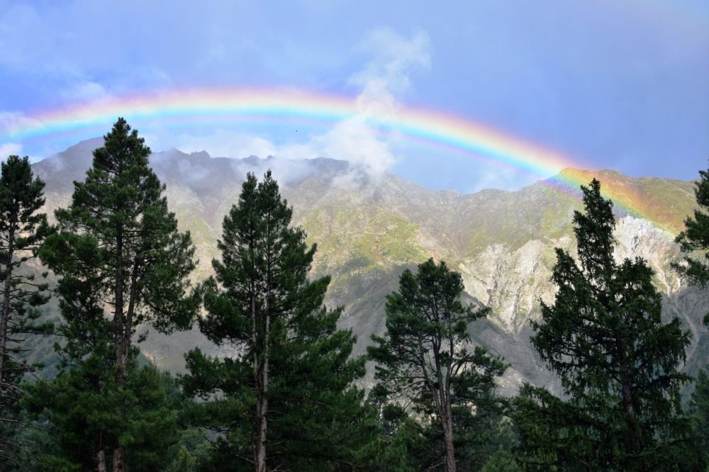 A rainbow over the mountains at Fairy Meadows
