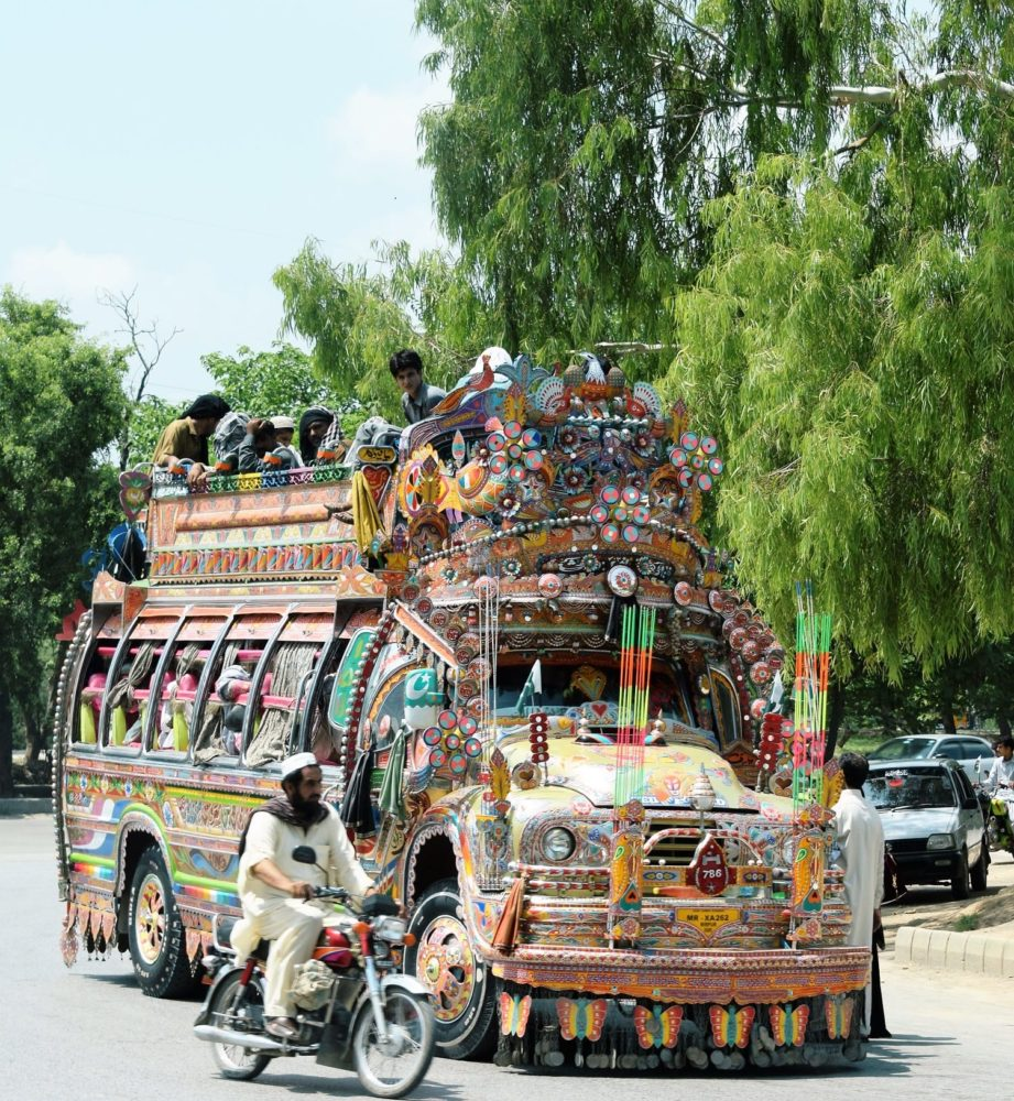 A highly decorated bus packed with passengers, Pakistan