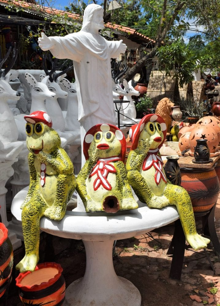 Pottery frogs surround the figure of Christ the Redeemer at Aregua Paraguay
