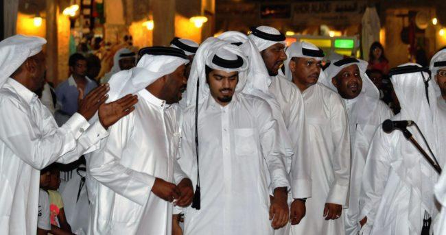 A group of Arab men dancing in Doha, Qatar