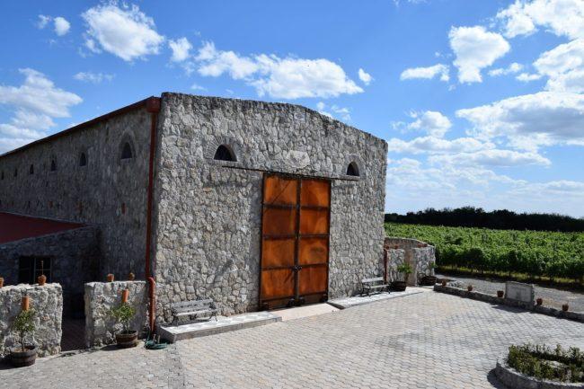 Stone vineyard buildings with wooden doors, Uruguay