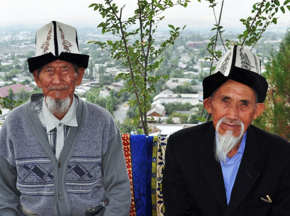 Two Kyrygyz men with white beards and tall felt hats