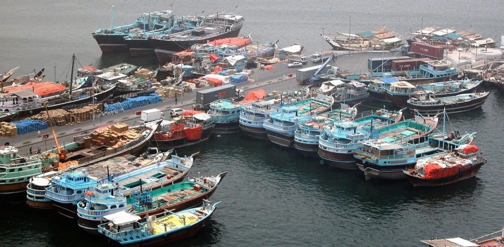 Fishing boats lined up on the quay at the Dubai Creek