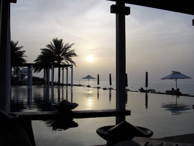 Sunset over the infinity pool at the Chedi, Muscat