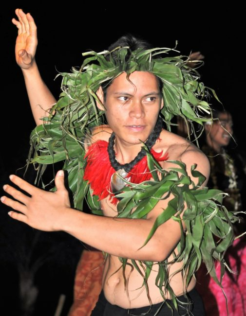 A Polynesian dancer with a leafy headdress