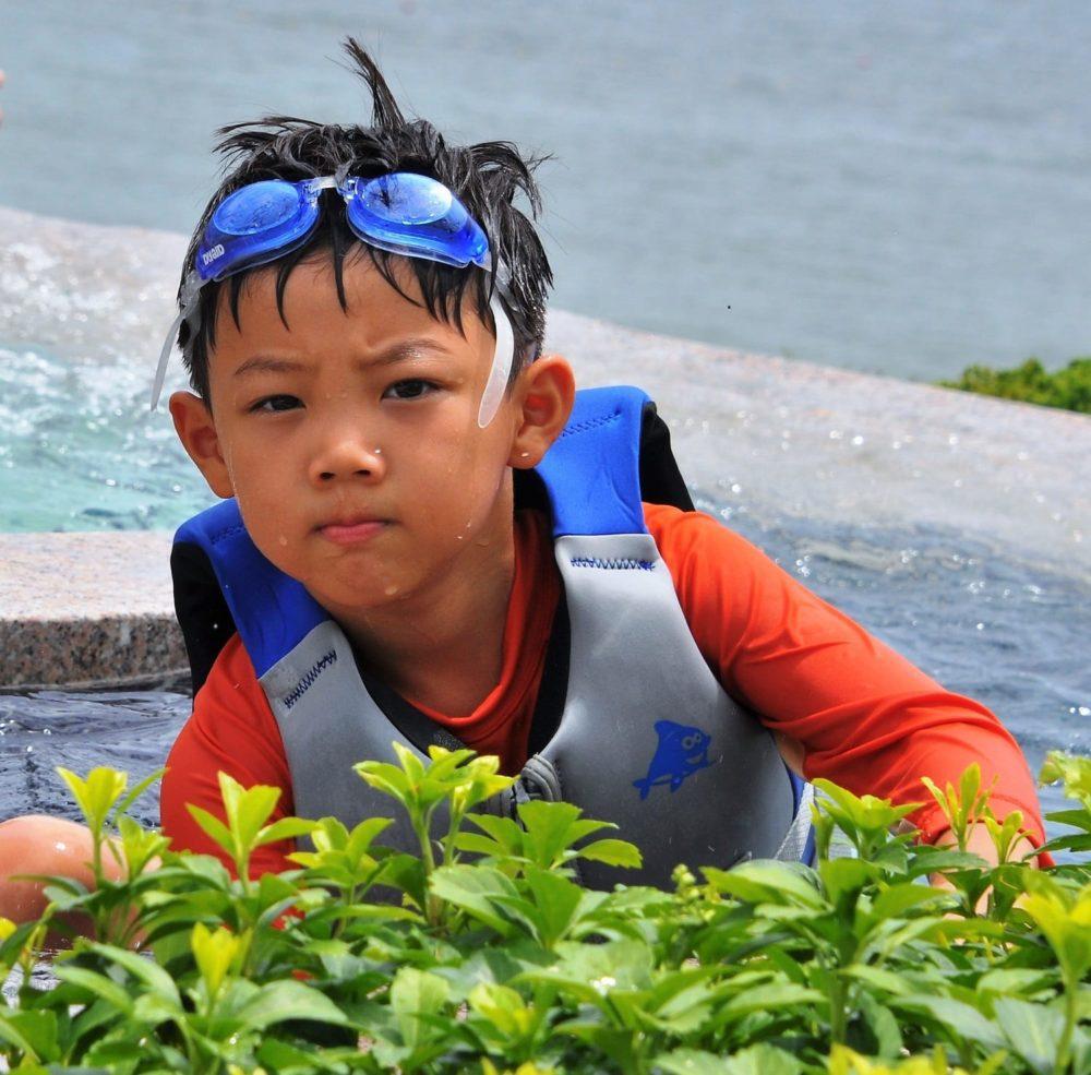 A small boy in his swim gear at the beach at Busan, South Korea