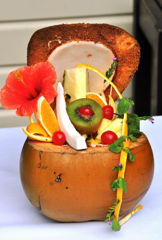 A decorated coconut filled with fruit