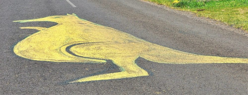 A large yellow kangaroo painted on the road in Samoa