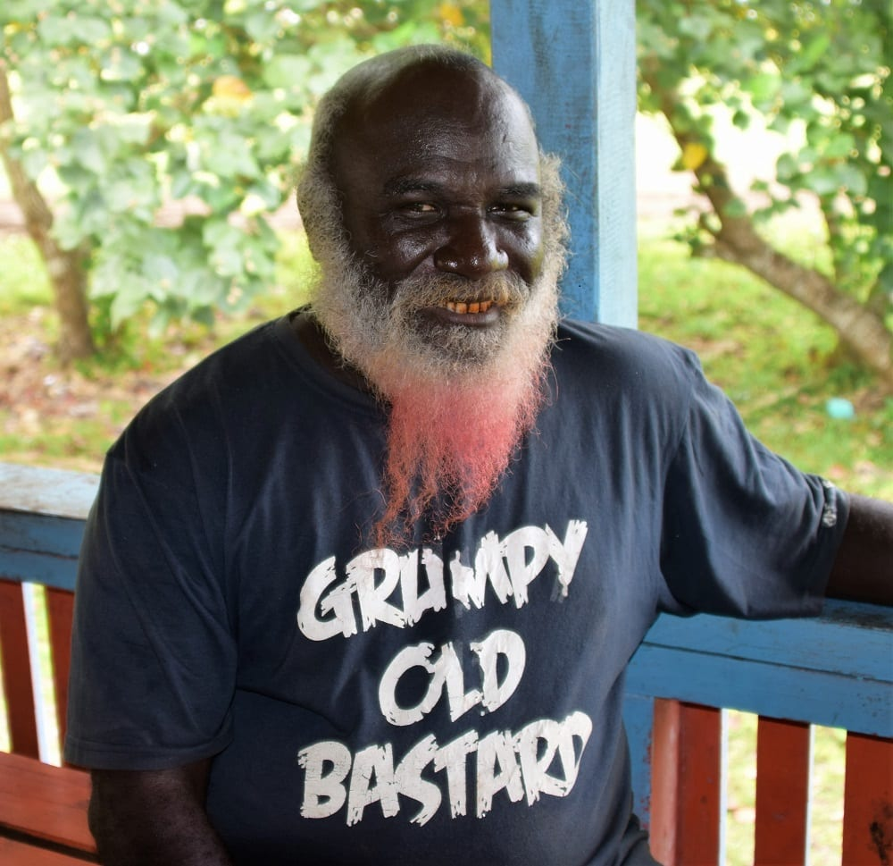 A local man with a beard dyed red and a Grumpy Old Bastard Tee shirt